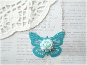 Image of Blue Butterfly with Light Blue Flower Necklace