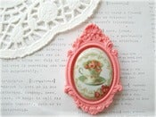 Image of Porcelain Floral Teacup in Salmon Resin Frame Brooch