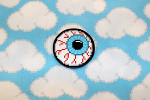 "Image of 1.5"" blue or purple eyeball pin"