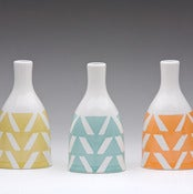 Image of triangle bottle vase