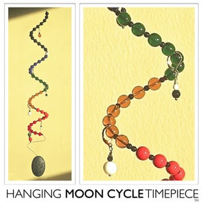 Image of Hanging Moon Cycle Timepiece | Glass | Black Vertebrae