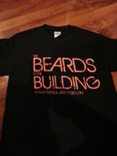 "Image of  ""BEARDS IN THE BUILDING"" BLACK WITH ORANGE PRINT TEE"