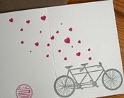 Image of heart with tandem bike