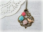 Image of Long Antique Brass Pendant with Resin Bird and Colourful Flowers Necklace