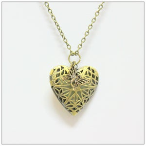 Image of Antique Filigree Perfumed Locket by Kelsey Hill
