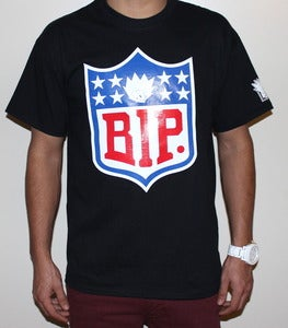 "Image of ""NFL"" Tee in Black"