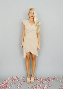 Image of Colette: Champagne nude wrap dress with high-low hemline...