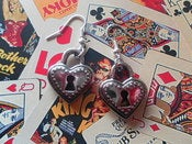 Image of Plastic Dark Antique Silver Coloured Heart Padlock Shaped Kitsch Retro Keyhole Earrings