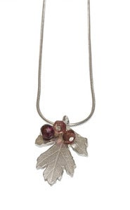 Image of Hawthorn pendant with cluster of tourmalines and garnets