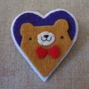 Image of pudgy bear + bowtie heart
