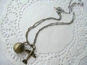 Image of Antique Brass Plane & Globe Necklace