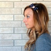 Image of the lil' leather bow- navy polka dot bow headband
