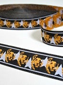 Image of Star Lion Black and Orange woven ribbon (by the metre)