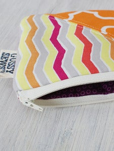 Image of Orange Zebra + Lattice square zip pouch