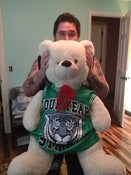 Image of Ryan's enormous childhood bear friend in a four year strong jersey