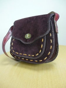 Image of heavy brown suede saddlebag handbag