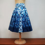 View full pleated skirt in original 1960s daube border print