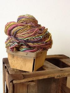 Image of muted rainbow. handspun yarn. 