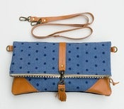 Image of foldover bag in hand stamped dots on denim