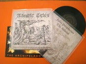 Image of Atomic Cries - Suspended Between the Mouth of God and the Fist of Man 7""