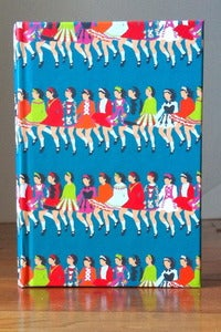 Image of Row of Dancers Turquoise Notebook