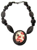 Image of Maiden Carved Resin Necklace by Hotcakes Designs