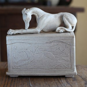 Image of Speckled box with Greyhound on top
