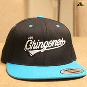 Image of Los Chingones snapback (black top/teal brim)