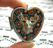 Image of Stag's Head miniature music box locket - speckled blue
