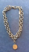 Image of Bronze double chain w coin