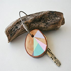 Image of hand painted Pine wood keychains by Nane Handmade