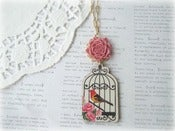 Image of Long Gold and Wooden Bird in Birdcage Necklace with Pink Flower
