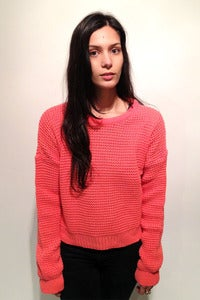 Image of knitted coral crop oversized jumper