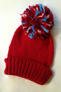 Image of hand knitted oversized pompom beanie
