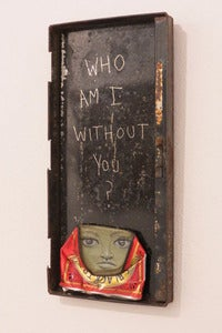 "Image of ""Who am I without you?"" can man in rusted metal box by Mydogsighs"