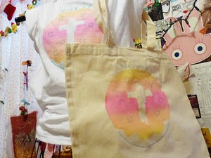 Image of eat me donut jesus tote bag